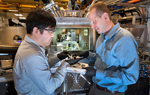 Yong Chu and Evgeny Nazaretski work in front of the new microscope they designed and installed at the Hard X-ray Nanoprobe beamline at NSLS-II.
